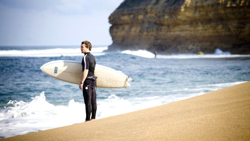 A watchful surfer surverys the scenes at Bells Beach