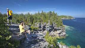 Two hikers admiring the view from Tobermory mountains