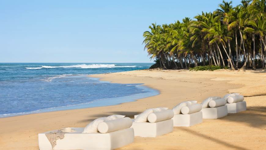 sun loungers on the beach at excellence punta cana
